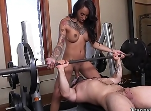 Huge learn of busty tranny bangs guy at one's fingertips the gym
