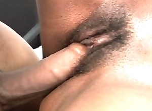 Naughty ebony babe Michelle Malone takes a big black cock in her off with on the desk