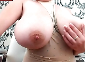 Sexy milf shows her huge boobs on video chat
