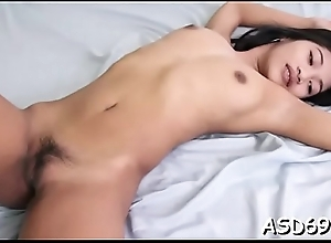 Voluptuous asian sex doll boasts of her one-eyed monster riding skills