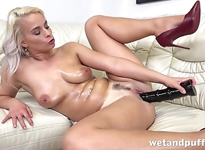 Tanned blonde cums from huge black dildo in all directions pussy